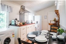 At Wild Orchid Olinda Cottage you will enjoy generous Breakfast provisions of local fresh produce. included in the price of your stay. The Kitchen is a lovely light bright space with everything you need to stay for a night, a week or a month.