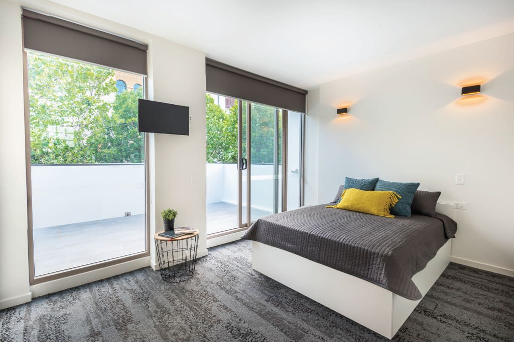 Bedroom with spacious balcony overlooking Foveaux St