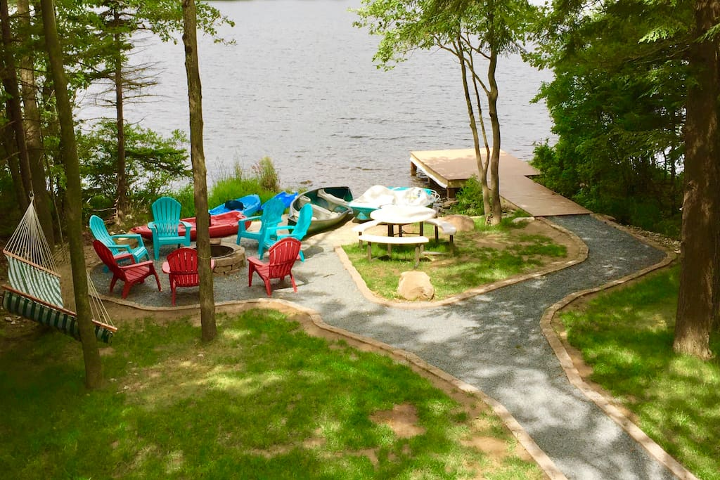 View from upper deck. Tress will be very pretty in the fall season. Enjoy conversation by fire pit, picnic lunch by the lake, or fishing on dock. Lots of boats to go out on lake.