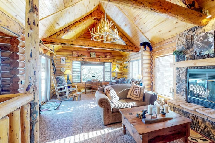 NEW LISTING! Cabin with private hot tub, lake and mountain views, large deck!