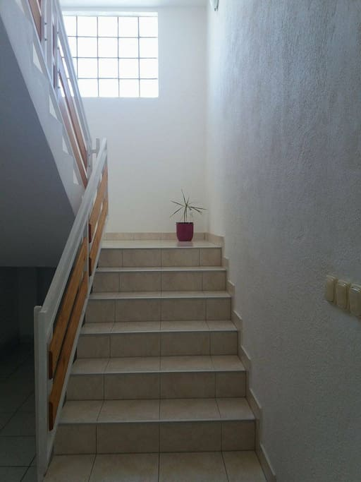 The stairs leading to the apartment