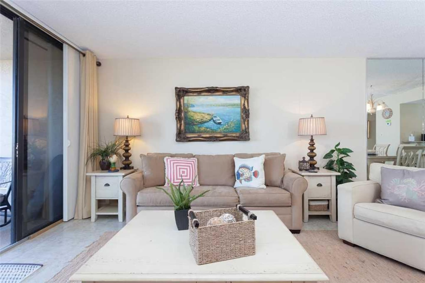 Our open-plan living area is airy and pleasant. - Enjoy the HDTV, comfy recliner, and cushioned couch of our living room. The vie
