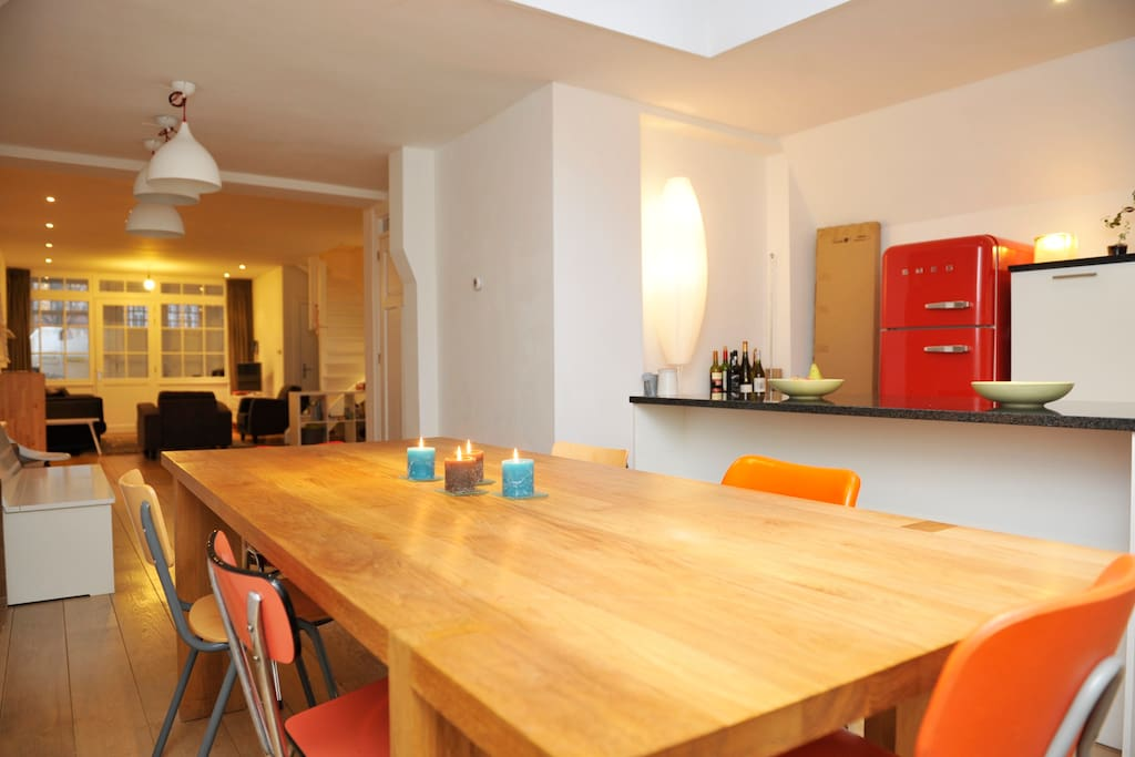 Solid wood dinner table seats 8 comfortably next to spacious chef's kitchen