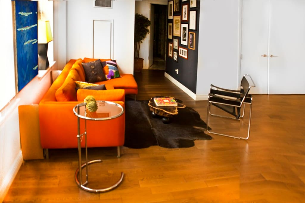Lounging on italian custom build sofa section and Marcel Breuer chair