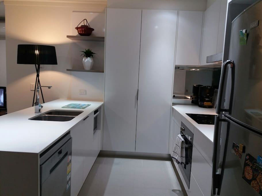 modern kitchen - dishwasher, microwave, electric hob, oven, coffee machine etc