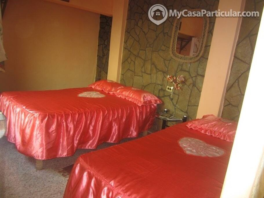 This room has 2 beds at your disposal, one queen size bed and a single bed