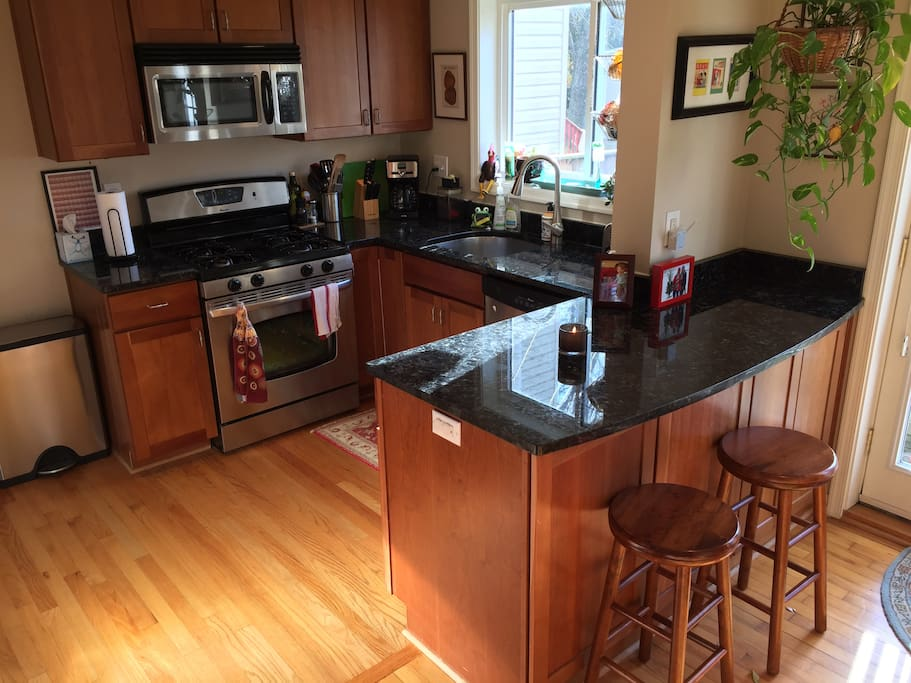 Kitchen with a breakfast nook, gas stove, refrigerator/freezer, dishwasher, and garbage disposal.