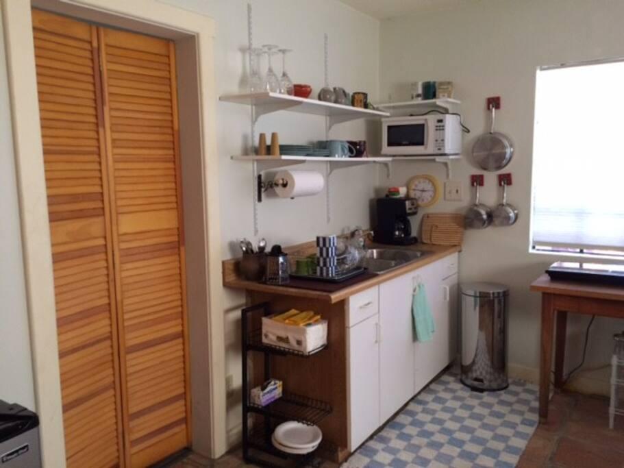 Kitchen area in the front room.  Door leads to bedroom.