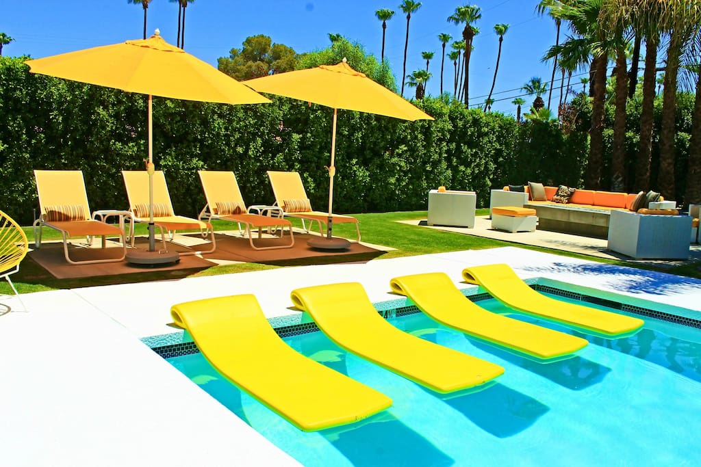 Plenty of pool floats, umbrellas and chaise lounges for everyone