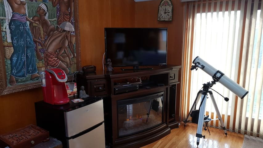 54 Inch TV with Bell Satellite - Keurig coffee maker and Frig with separate freezer