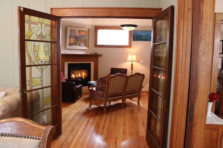 Cozy up to a warm fire in a historic home with modern amenities.  The fireplace can be enjoyed from the dining room and kitchen as well.