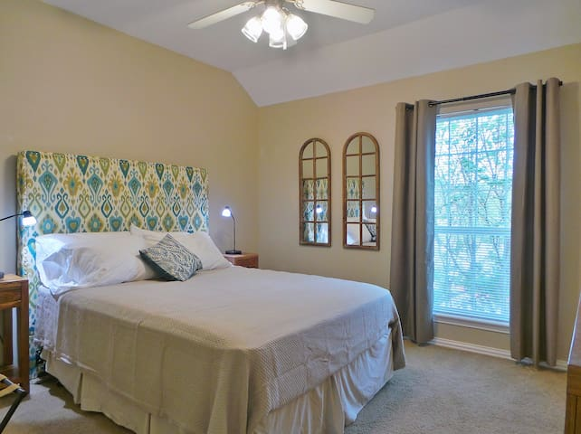 This upstairs bedroom also features a queen bed.