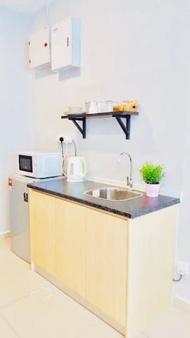 Kitchenette with microwave, fridge and kettle