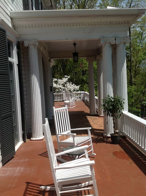 The front porch of Springwood Inn with rockers to enjoy the view.