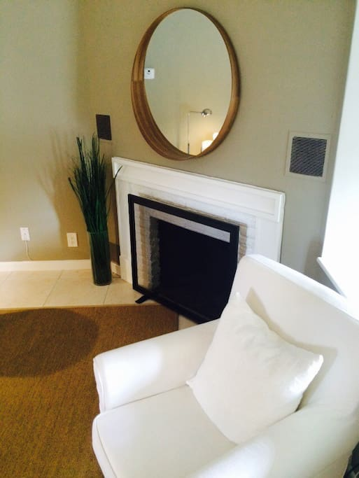 Wood burning fireplace with reading chair