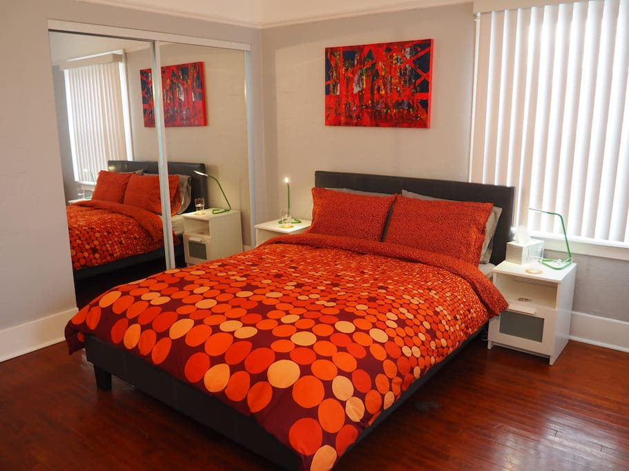 Main room with queen bed and closet