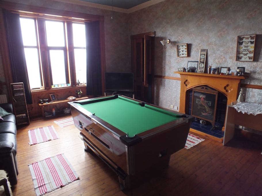 Pool table, surround sound TV and large library.  Sea view