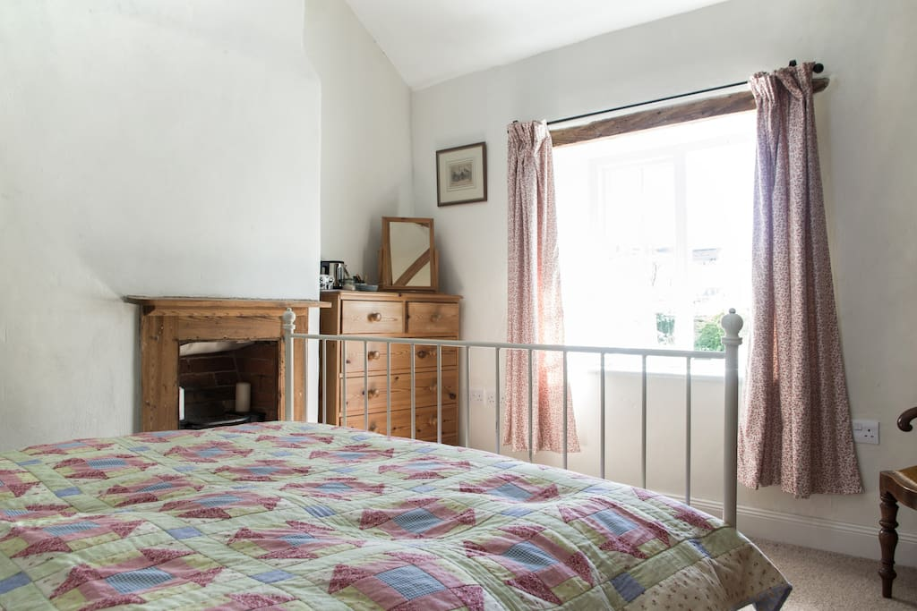 This is our guest room. It is in the old part of the house - one of the original cottage rooms with an open, beamed ceiling and views over the front garden.