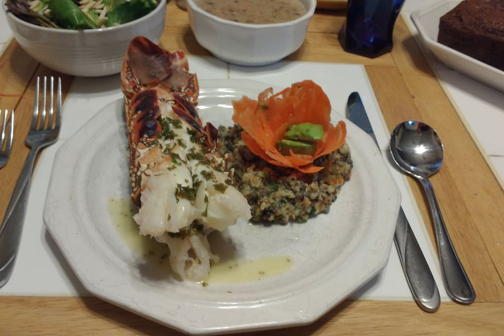 Sample dinner-Baked lobster with garlic parsley lemon butter, rice pilaf with carrot avocado flower, seafood bisque, salad