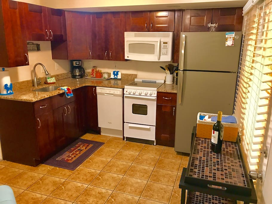 New deluxe kitchen with solid cherry cabinets, granite tops, premium appliances. Yes, includes DW too.