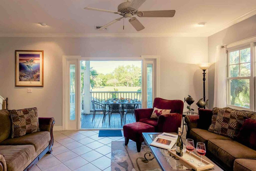 The living area faces the fairway and has multiple comfortable seating options...
