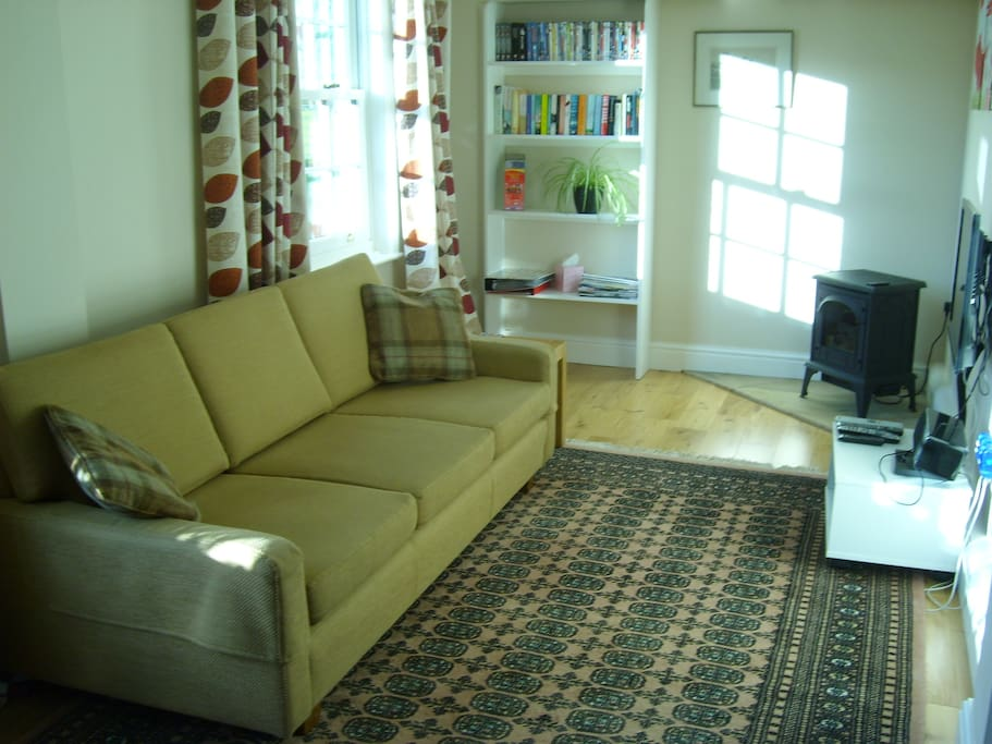Sunny sitting area with satellite TV, a large selection of DVDs, books and information about Yorkshire