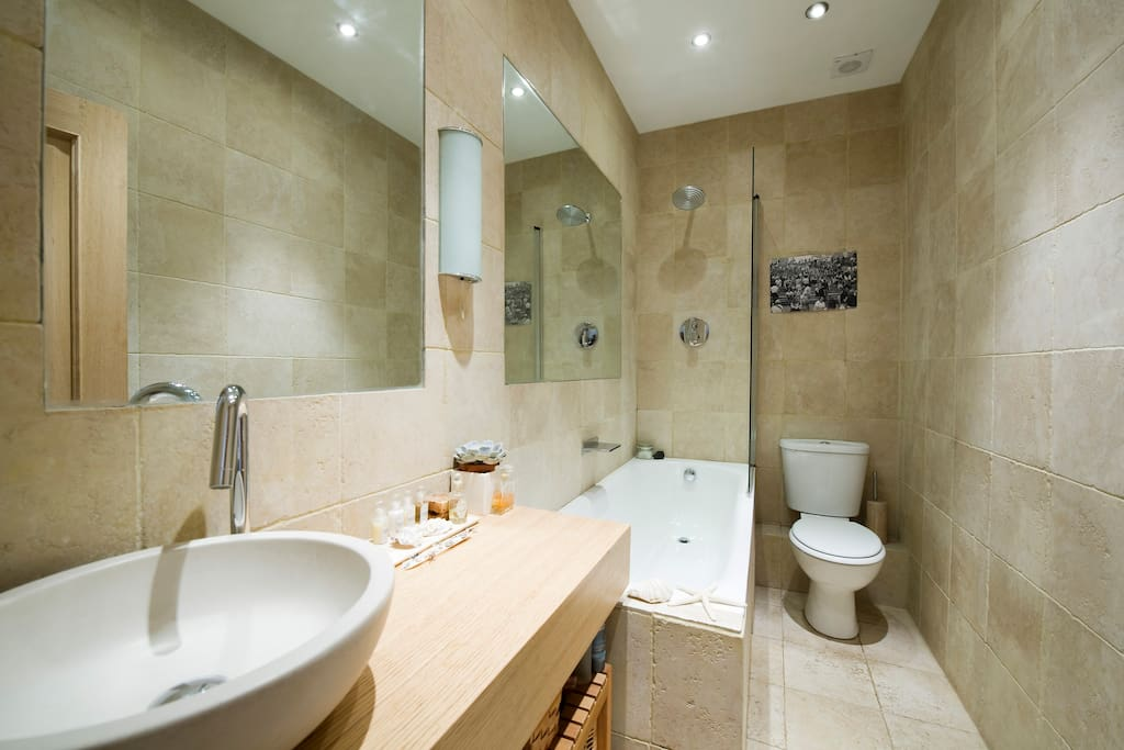 Start your day refreshed and ready for anything London has to offer with our giant rainfall shower and marble sink. Unwind after a day of sightseeing in our full size bath with central waterfall tap.