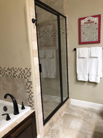 Take your pick between a soaker tub or a spacious shower!