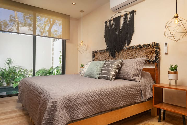Master bedroom with king size bed -  private swim up pool right outside.