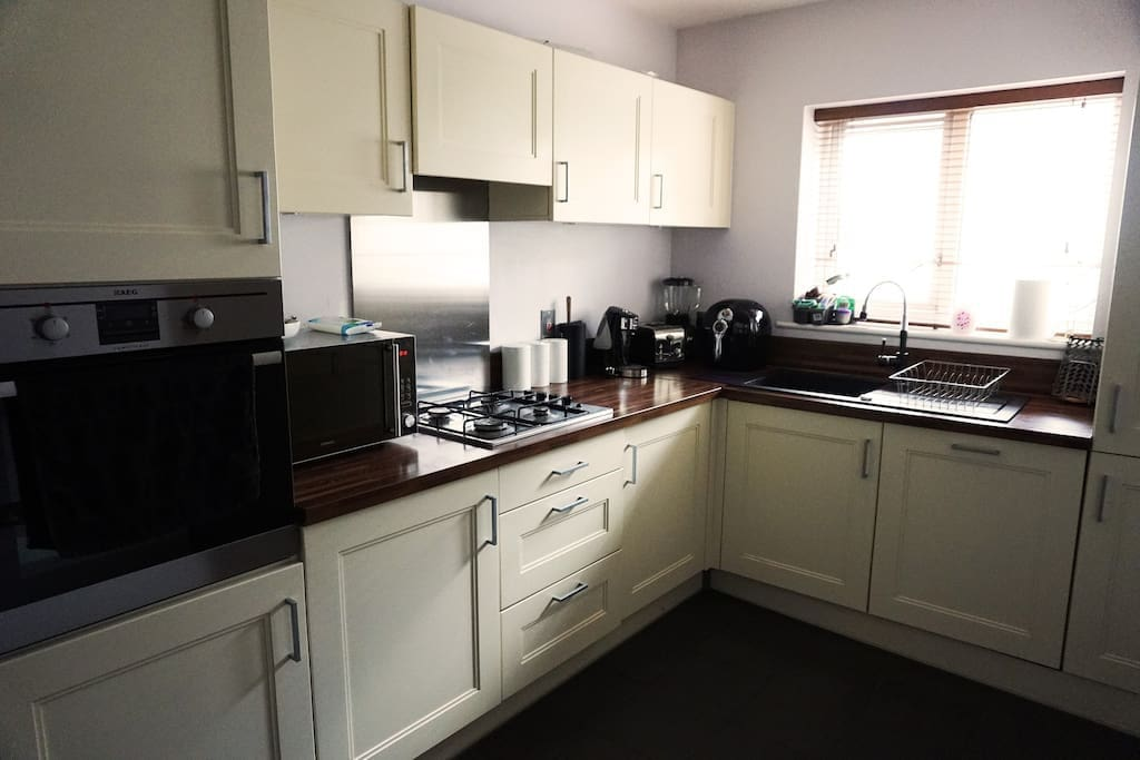 fully equipped kitchen with fridge freezer, dishwasher, washing machine, dryer, convecter microwave, oven/ grill, hot water dispenser, air fryer, blender, toaster and lots of storage including a dining area.