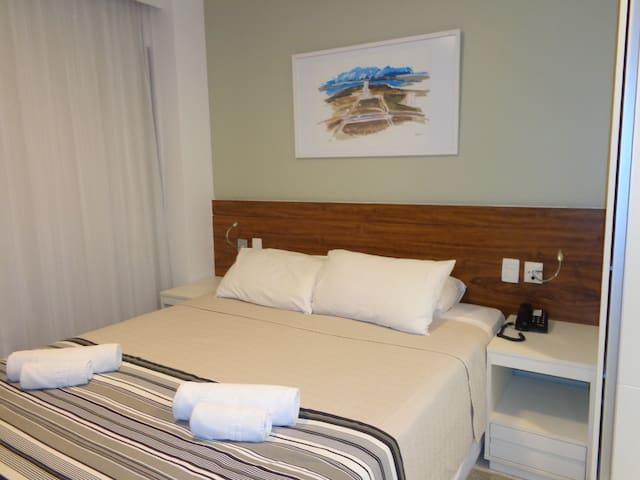 Flat confortável e cama aconchegante