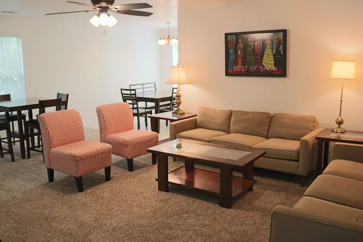 Living room with 2 full size sofas.  2 tables for dining seating 10 people.