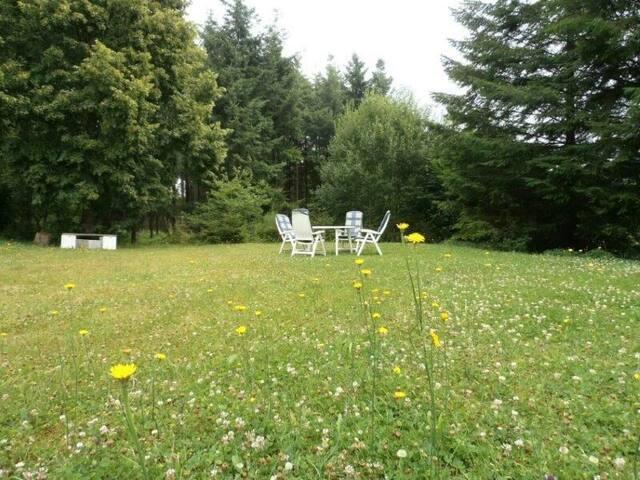 Grote tuin ter beschikking van de gasten.