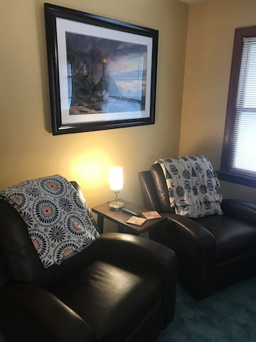 Relax into leather recliners while watching a 50 inch TV
