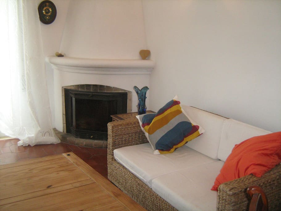 Seating for four and fireplace