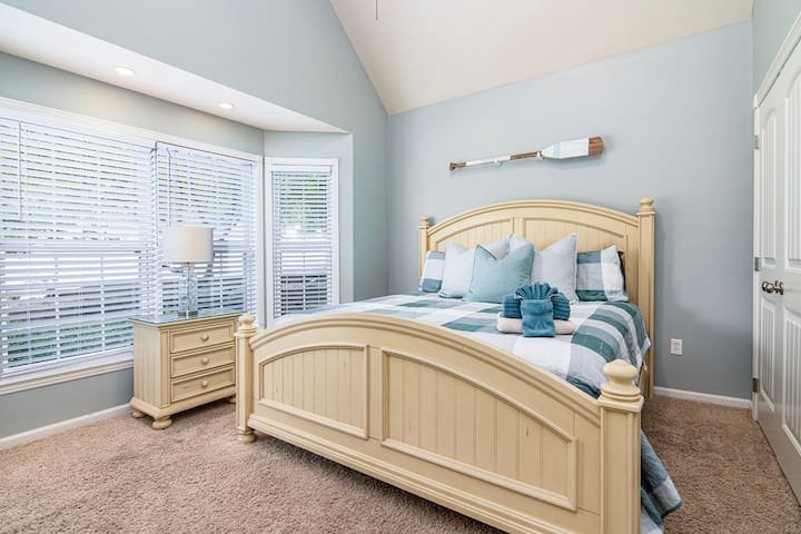 The spare bedroom on the main level has a king size bed as well as an attached bathroom!