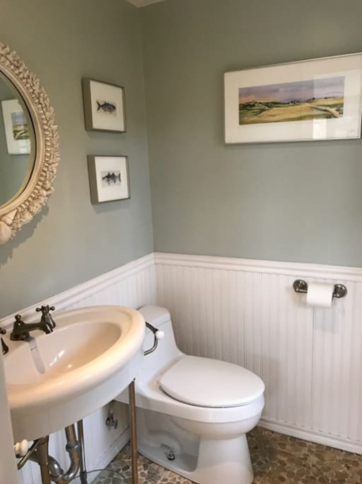 The half bath is located in the open concept living space.