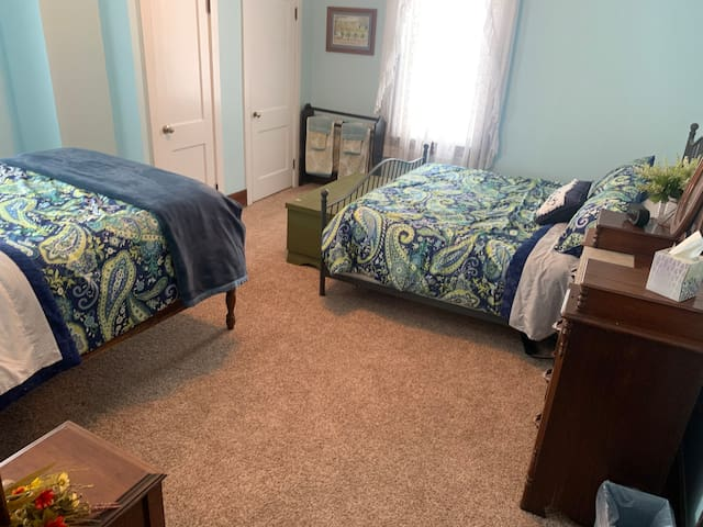 This room accommodates 4 adults comfortably. One king bed, one double bed.