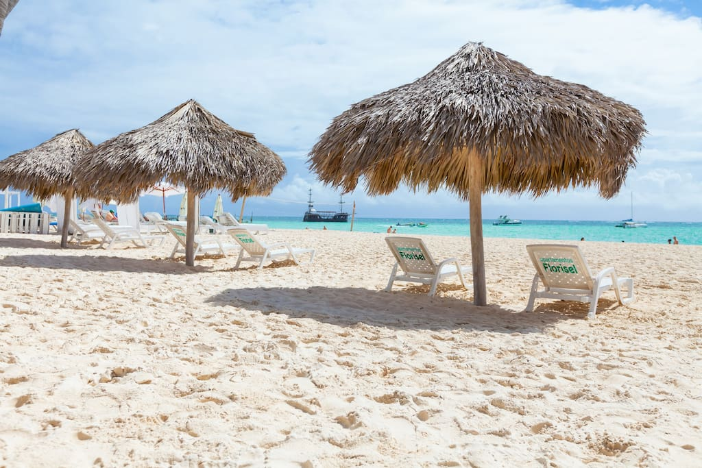 Our private beach with private loungers and parasols