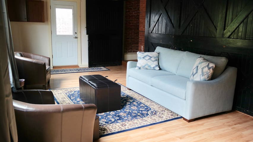 Historical Carriage House recently renovated into beautiful home.  Living Room has pull out couch.