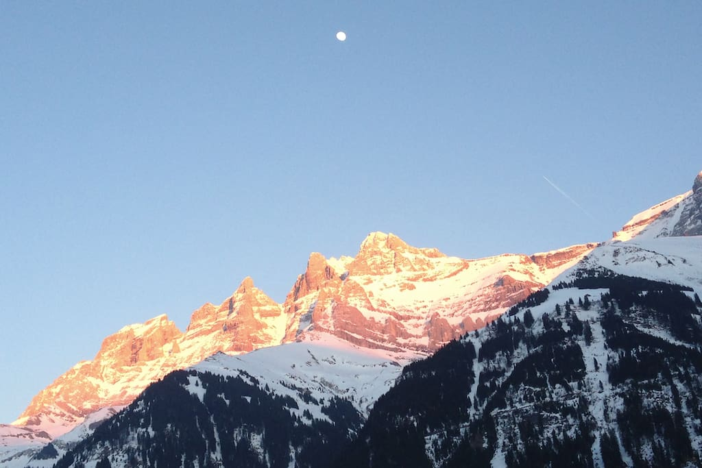 view from the chalet, sunset at wintertime, with moon rising