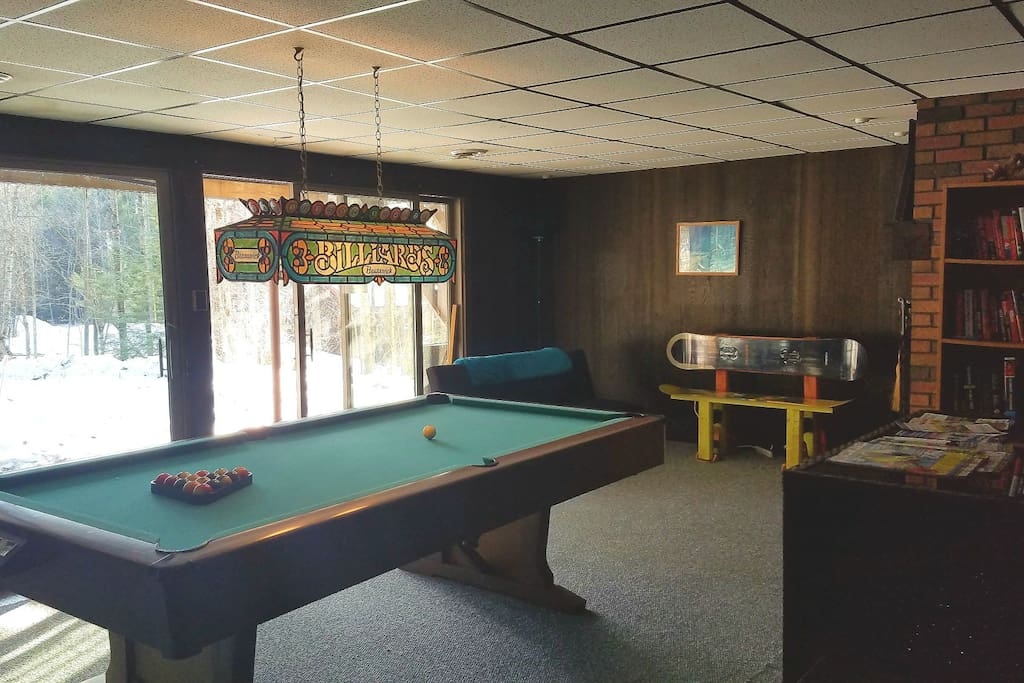 Pool table on first floor, casual seating with TV.