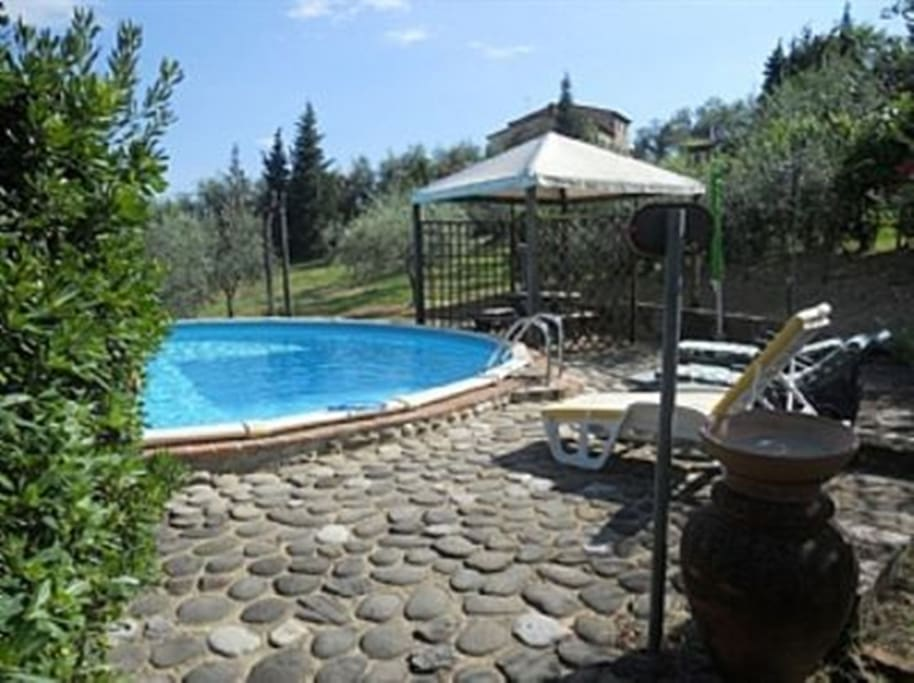 Nice area surrounds the pool with a covered eating area
