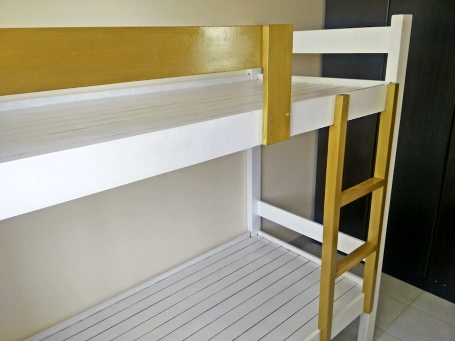 Customized bunk beds to maximize the bedroom space.