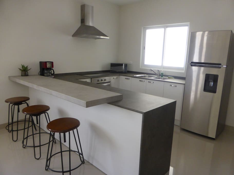 Fully equipped modern kitchen with all appliances.
