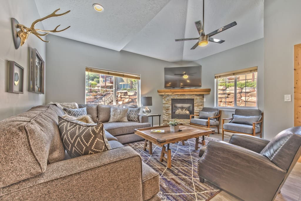 """Main Level Living Room with Mountain Contemporary Furnishings, a Gas Fireplace and 65"""" HD Smart TV / Ultra HD Blu-Ray DVD, Apple TV and Sonos Sound System"""