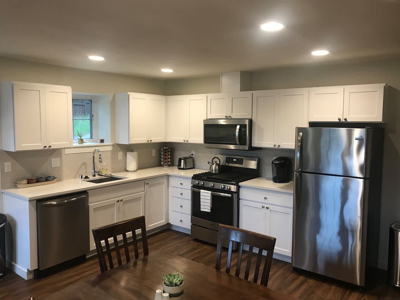 You will love cooking in this kitchen with beautiful countertops and new stainless steel appliances! Spices, utensils, and all the pots and pans you could ever need.