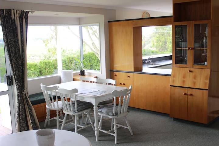 Dining area adjoining kitchen. Cosy Bay window to enjoy the view.
