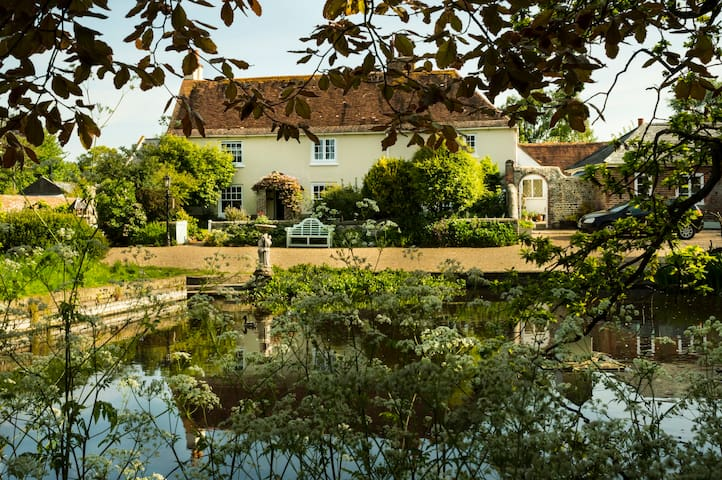 Traditional farmhouse with duckpond