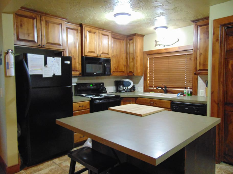 Kitchen with refrigerator, stove/oven, microwave, and dishwasher.